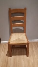 4 x high backed chairs suitable for kitchen / dining room in wood with wicker seat