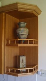 matching pair of corner shelves finished in oak with balustrades