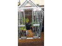 Glass greenhouse.4ftx4ft.height 6ft.aluminium frame,sliding doors ,window i roof