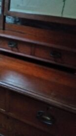 Wooden chest of drawers with mirror