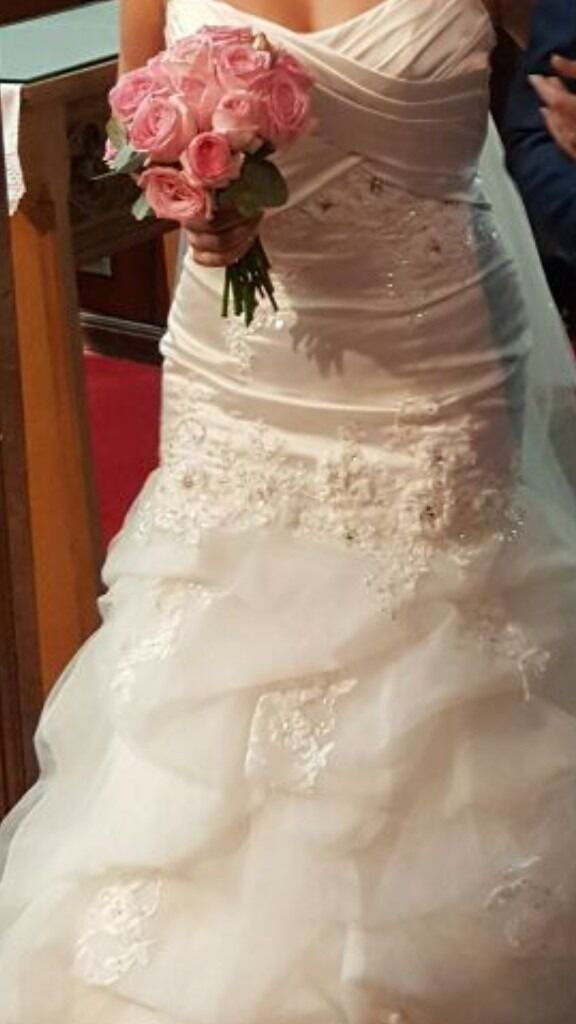 Wedding dress65 onoin NewportGumtree - Beautiful white wedding dress,good condition will fit size 8 12 as lace up back. Needs dry cleaning this is why selling so cheap. Grab a bargain