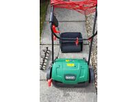 Qualcast Scarifer and raker, excellent condition. Still have box