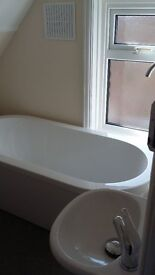 Contemporary free standing bath tub with free standing mixer /shower tap £150