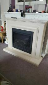 Remote control electric fire and fireplace.