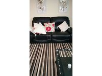 Brand new two, two Seater Leather Sofas.