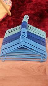 27 blue coat hangers