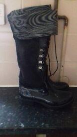 Lovely long black boots brand new.