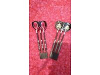 complete darts kit, the board, the wall case with score board and 2 sets of darts