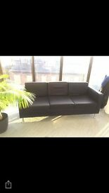 Three seater black leather sofa and armchair