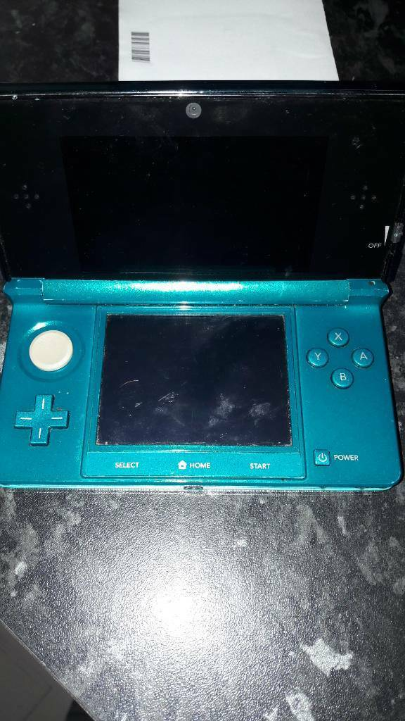 Nintendo 3 ds with 4 games