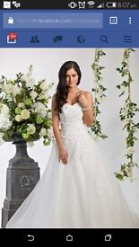 BRAND NEW wedding dress for sale. Size 14. New reduced price.