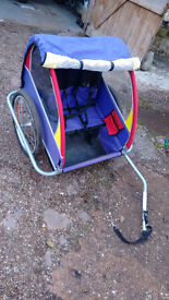 Bike trailer for carrying up to 2 children. Folds flat for storage. All fittings and raincover inc.
