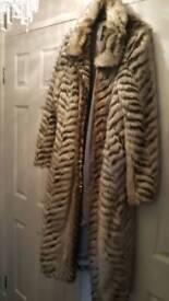 Ladies stunning smokey grey/ white long fur coat