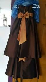 2 flower girl dresses. Brown burnt orange. Ages 3-4 & 7-8