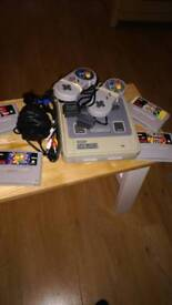 Super Nintendo with 4 top games and 2 pads
