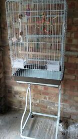 Large white bird cockatiel cage, includes 3 wooden bird perches, 7 bird toys, and a wheeled stand