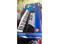 Yamaha Electric Keyboard with stand