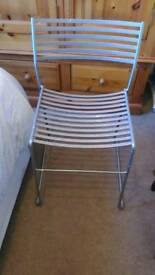 Metallic effect chair