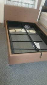 A brand new stylish mocha double bed ottoman frame.