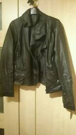 Women's leather jacket and Adidas trainers