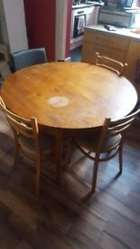 Circular extender table and 4 chairs. Seats 4-6 people