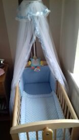 NEW wooden crib with NEW blue dimple bumper and quilt