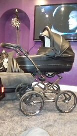 Vib black leather pram excellent condition comed with buggie part and leatherfootmuff and raincover
