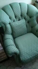 Green fabric old Chesterfield site 1 winged back chair 1 tub chair and sofa with brass casters.