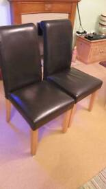 Brown faux leather dining chairs . Roll top.