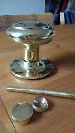 Round brass door knob, brand new