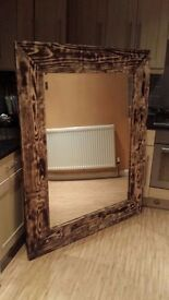 very large hand made mirror.