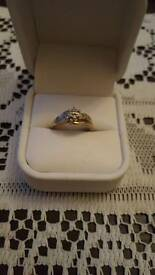 9ct yellow gold diamond solitaire.