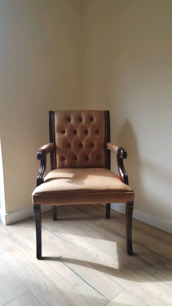 Vintage leather arm chairs