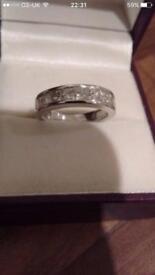 Beautiful white gold half eternity ring