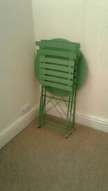 Table and 2 chair dining set. Green, kept inside, no marks or rust, like new