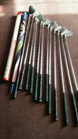Foldup golf trolley and bag with some irons and driver,some balls and an umbrella