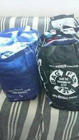 Two big bags full of baby boy clothes