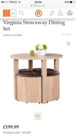 Compact dining table and stools