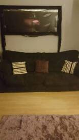 4 seater black fabric settee