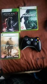 Xbox 360 games and black controller (rechargeable)