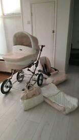 Baby style pink and white pram