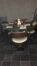 Extendable glass dining table with 4 swivel chairs