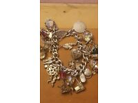 Old silver charm bracelet and three gold necklace and bracelet set