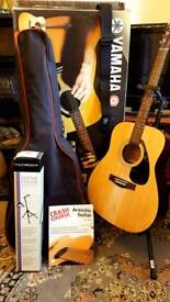 Yamaha F310 acoustic guitar with case and stand