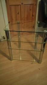 Small heavy clear glass TV stand