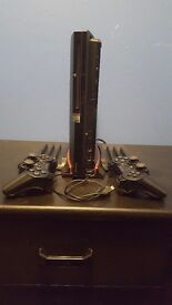 PS3 320GB SLIM with 2 controllers playstation move set. A stand for the PS3 and 16 games.