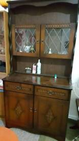 Vintage dark wood dresser with glass display cabinet