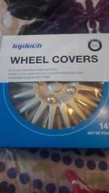 "14"" wheel trims - unopened"