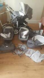 Double pram with two carrycots,catseats,raincover and changing bag