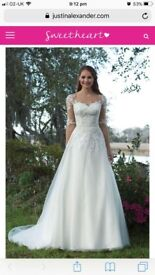 Organza and Satin A-Line gown with illusion sleeves and lace appliques